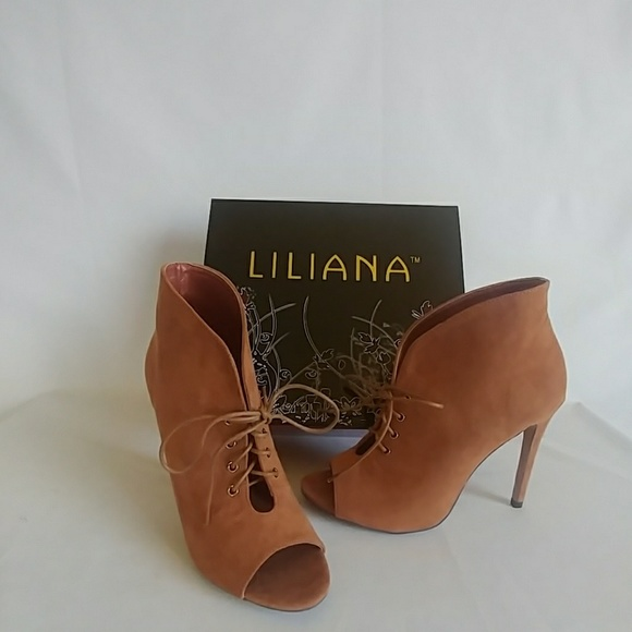 98fca756b405 Tan lace up ankle high heel booties